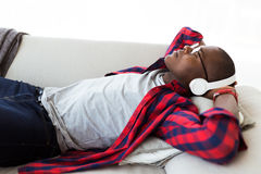 Handsome young man listening to music with headphones at home. Portrait of handsome young man listening to music with headphones at home Stock Image