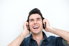 Handsome young man listening to music on headphones and smiling Royalty Free Stock Image