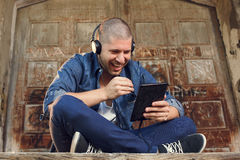 Handsome young man listening to music Stock Photos