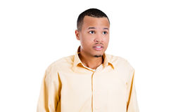 Handsome young man looking away in shock and surprise Royalty Free Stock Photography