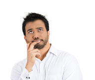 A handsome young man lost in deep thoughts looking upwards Stock Photography