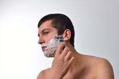 Handsome young man with lots of shaving cream on his face prepar Royalty Free Stock Image