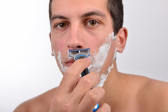 Handsome young man with lots of shaving cream on his face prepar Stock Images