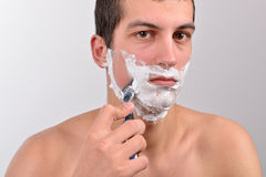 Handsome young man with lots of shaving cream on his face prepar Royalty Free Stock Images