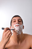 Handsome young man with lots of shaving cream Stock Image