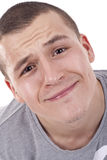Handsome young man making a funny face Stock Photography