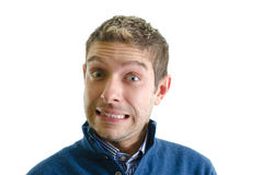 Handsome young man making funny face Stock Images