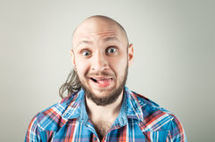 Handsome young man making funny faces Royalty Free Stock Photo