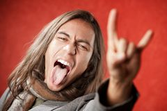 Handsome Young Man Making a Hand Gesture Royalty Free Stock Photography