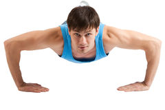 Handsome Young man making push-ups. Isolated Royalty Free Stock Photography