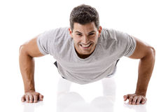 Handsome young man making pushups Stock Photography