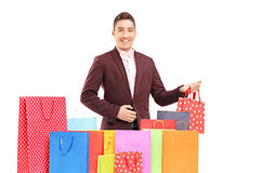 Handsome young man with many shopping bags Stock Photography