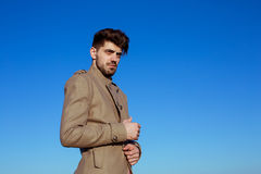Handsome young man in a military jacket Royalty Free Stock Images