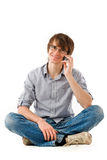 Handsome young man with mobile phone Stock Images