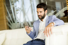 Handsome young man with mobile phone Royalty Free Stock Photos