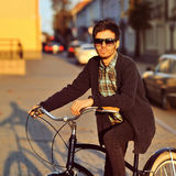 Handsome young man model biking in the city Stock Image