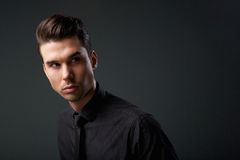 Handsome young man with modern hairstyle Royalty Free Stock Photo