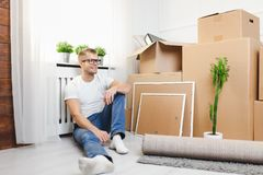 Handsome young man moving to a new home royalty free stock images