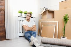 Handsome young man moving to a new home stock images