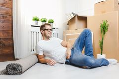 Handsome young man moving to a new home royalty free stock photography