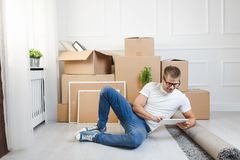 Handsome young man moving to a new home royalty free stock photos
