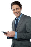 Handsome young man navigating on his smartphone Stock Photo