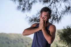 Handsome young man near sea, pine branch and mountain background in Turkey. Handsome young man near sea, pine branch and mountain background in a summer day in Stock Images