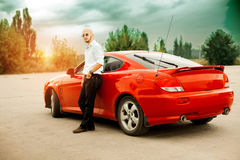Handsome young man near sport car royalty free stock photo