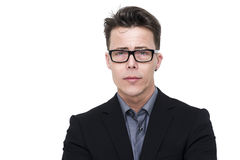 Handsome young man in nerdy glasses. Handsome young businessman, professor or student in nerdy glasses with a serious expression and perplexed frown looking Stock Images