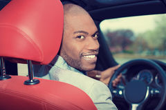 Handsome young man in new car driving Stock Images
