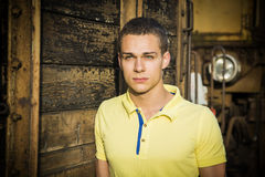 Handsome young man next to wood planks wall Stock Photography