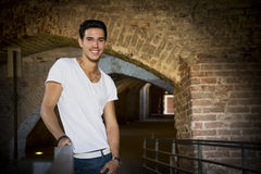 Handsome young man in old building smiling Royalty Free Stock Photo