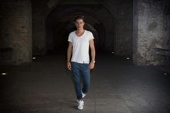 Handsome young man in old building walking inside gallery Stock Images