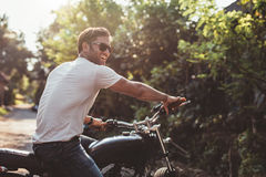 Free Handsome Young Man On Motorcycle Royalty Free Stock Image - 76640326