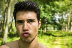 Handsome young man outdoor doing silly face Royalty Free Stock Photo
