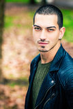 Handsome young man outdoors, short hair style Stock Photography