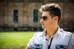 Handsome young man outdoors wearing sunglasses Stock Photo