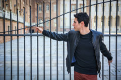 Handsome young man outside historical building in European city Stock Images