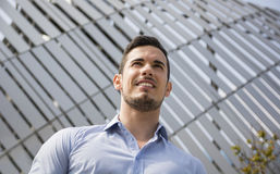 Handsome young man outside wearing shirt, smiling Stock Photos