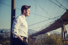 Handsome young man outside wearing white shirt Royalty Free Stock Photos