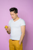 Handsome young man with a pear Stock Image