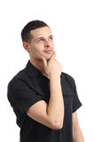 Handsome young man pensive and looking at side Royalty Free Stock Photo