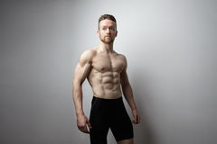 Handsome young man with perfect muscule body posing. Stock Photo