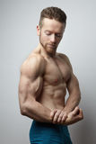 Handsome young man with perfect muscule body posing. Royalty Free Stock Photo