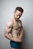 Handsome young man with perfect muscule body posing. Royalty Free Stock Image