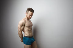 Handsome young man with perfect muscule body posing. Stock Images