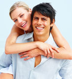 Handsome young man piggybacking his girlfriend Royalty Free Stock Photos