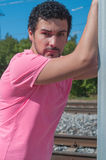 Handsome young man in pink t-shirt Royalty Free Stock Photo