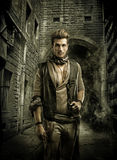 Handsome Young Man in Pirate Fashion Outfit. Good Looking Young Man in Pirate Fashion Outfit in Old Medieval Town Street Stock Photos