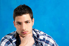 Handsome young man with plaid shirt on blue Stock Photo